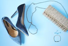 Woman styled fashion clothes and accessories on light blue background. royalty free stock photo