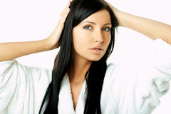 Woman styling hair Royalty Free Stock Images