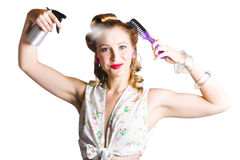 Woman styling her hair Stock Image