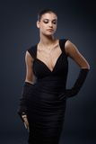 Woman in stylish black cocktail dress Royalty Free Stock Photography