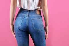 Woman in stylish blue jeans. On color background royalty free stock photos