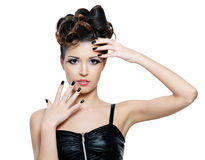 Woman with stylish hairstyle and black nails. Beautiful glamour woman with stylish hairstyle and black nails royalty free stock images