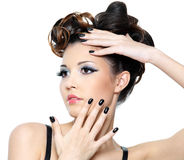 Woman with stylish hairstyle and black nails. Beautiful glamour woman with stylish hairstyle and black nails. Fashion eye make-up stock photography