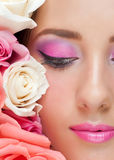 Woman with stylish make-up and roses royalty free stock photography