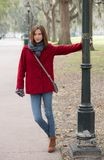 Woman in a Stylish Red Coat Stock Images