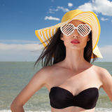 Woman in stylish swimsuit on beach Stock Photography