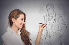 Woman stylist. Drawing sketch of male model dressed in suit Stock Photography