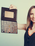 Woman stylist holding eyeshadow makeup palette. Stock Photography