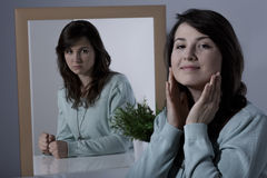 Woman subduing her feelings. Image of hypocritical woman subduing her feelings Stock Photos