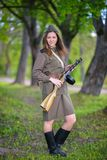 Woman in a submachine gun in hands royalty free stock image