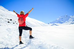 Woman success, business concept in winter mountains Royalty Free Stock Image