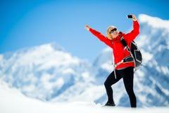 Woman success selfie on mountain peak Stock Photo