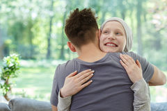 Woman after successful therapy. Young happy women hugging her husband after successful therapy Stock Photo