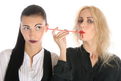 Woman sucks blood from an ear other woman Stock Image