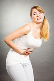 Woman suffer from belly pain. Stock Images