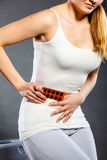 Woman suffer from belly pain holds pills in toilet Royalty Free Stock Photos
