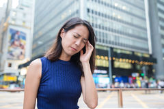 Woman suffer from headache. In Hong Kong Royalty Free Stock Image
