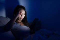 Woman suffer from headache with using cellphone at night. Asian young woman Stock Photos