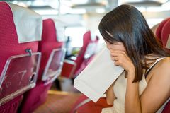 Woman suffer from seasick. Asian young woman portrait Stock Image