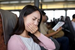 Woman suffer from seasick on boat Stock Photos