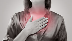 Woman suffering from acid reflux or heartburn. Gastroesophageal reflux disease Stock Photos