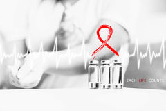 Woman suffering from AIDS doing puncture behind AIDS symbol Royalty Free Stock Photo