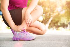 Woman suffering from an ankle injury while exercising. Running s stock images