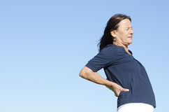 Woman suffering from back pain Royalty Free Stock Photography