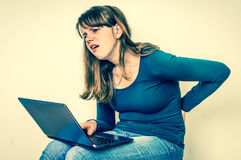 Woman is suffering from back pain - bad posture concept Royalty Free Stock Image