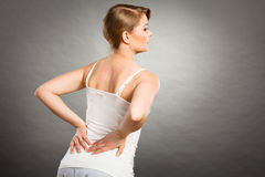 Woman suffering from back pain Stock Images