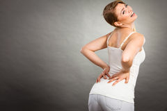 Woman suffering from back pain Royalty Free Stock Photo