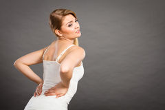 Woman suffering from back pain Royalty Free Stock Photos