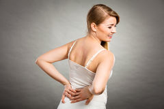 Woman suffering from back pain Royalty Free Stock Image