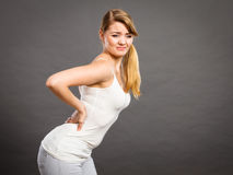 Woman suffering from back pain Stock Photography