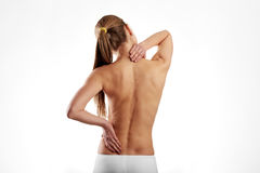 Woman suffering from backache. Naked woman torso with painful back. Lumbago problem Stock Photography