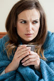 Woman suffering from cold Stock Photography