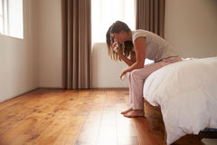 Woman Suffering From Depression Sitting On Bed And Crying Royalty Free Stock Photography