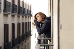 Woman suffering depression and stress outdoors at the balcony Royalty Free Stock Images