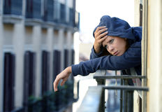 Woman suffering depression and stress outdoors at the balcony Stock Image