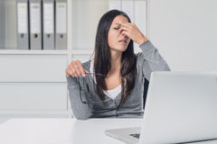 Woman suffering from eye strain at her laptop Stock Photography