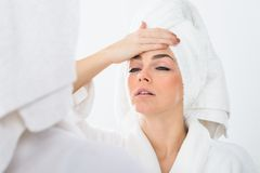 Woman suffering from fever Stock Images