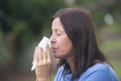 Woman suffering flu or hayfever outdoor Stock Photo