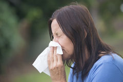 Woman suffering flu sneezing in tissue Stock Photos