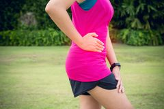 Woman suffering have stomach pain,Female runner side cramps after sport exercise running royalty free stock photos