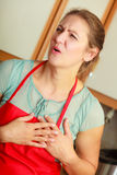 Woman suffering from having heart attack. Stock Images