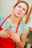 Woman suffering from having heart attack. Royalty Free Stock Photo
