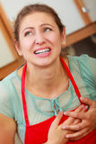 Woman suffering from having heart attack. Stock Image