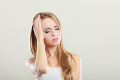 Woman suffering from head pain Stock Image