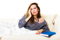 Woman suffering from head pain taking power nap Royalty Free Stock Photo