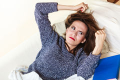 Woman suffering from head pain taking power nap Stock Image
